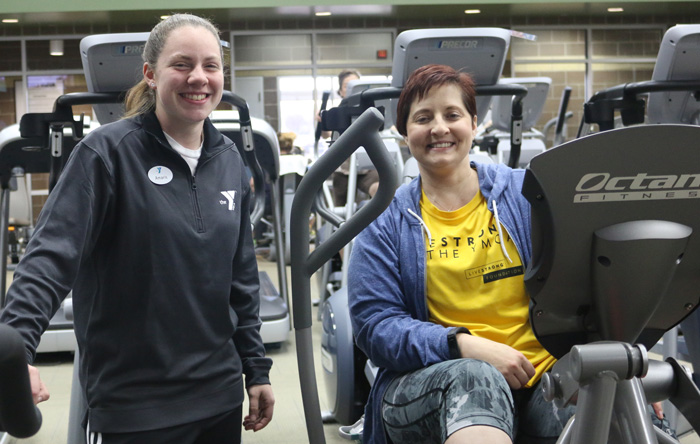 Jennifer R. is now a member at the Earlywine YMCA. She has been fighting cancer for more than 9 years. Amaris S., a staff member, demonstrates how to use the xRide xR6000 workout boosters.
